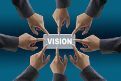 Vision of diverse business team. A diverse business team with hands together push vision button Royalty Free Stock Images