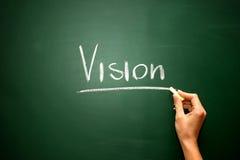 Vision en la pizarra con la escritura de la tiza fotografía de archivo