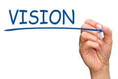 Vision - female hand writing blue text. With marker on white background Royalty Free Stock Photos