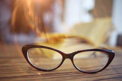 Vision glasses on table. Vision glasses on wooden table stock photos