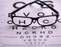 Eye vision chart with glasses royalty free stock images