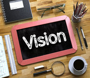 Vision Handwritten on Small Chalkboard. 3D. Stock Photos