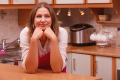 Dreaming housewife at home Royalty Free Stock Photos