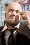 Vision Impared Monocle Man. Vision Impared Squinting Monocle Man Looks Though Monicle Stock Photos