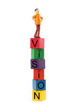 Vision. Man on the top of building blocks spelling vision isolated on white background Royalty Free Stock Image