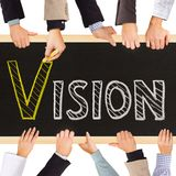 Vision. Photo of business hands holding blackboard and writing VISION concept Stock Image