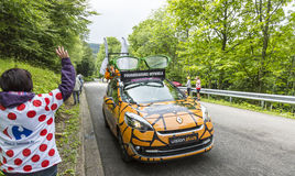 Vision Plus Car. Le Markstein, France- July 13, 2014:Vehicle advertising Vision Plus during the passing of the Publicity Caravan in front of exciting spectators royalty free stock images
