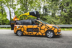 Vision Plus Car. Le Markstein, France- July 13, 2014:Vehicle advertising Vision Plus during the passing of the Publicity Caravan on mountain pass Le Markstein royalty free stock images