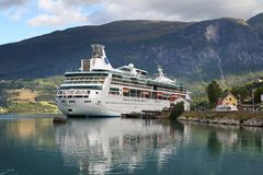 Vision of the Seas. OLDEN, NORWAY - AUGUST 20, 2010: MS Vision of the Seas anchored in Olden, Nordfjord. The cruise ship is operated by Royal Caribbean Cruises Stock Images