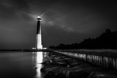 Vision is seeing the invisible. Barnegat lighthouse by night in black and white   in Barnegat Light, NJ Royalty Free Stock Photo