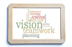 Vision teamwork. Word cloud on a wooden board stock photo
