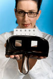 Vision Test. Eye doctor with retro vision testing device Stock Photo