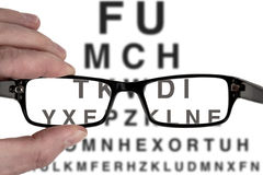Vision test. Male hand holding black spectacles frame for vision eye examination test Royalty Free Stock Images