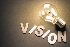 Vision. Wood letters as Vision word with light bulb Stock Photography