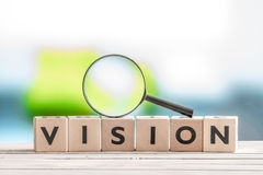 Vision word and a magnifying glass Royalty Free Stock Photography