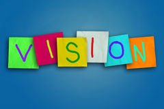 Vision. The word Vision written on sticky colored paper Royalty Free Stock Photos