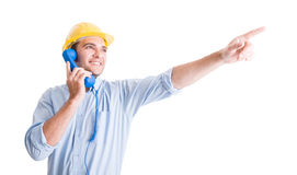 Visionary architect talking on phone and pointing. Finger up showing something Royalty Free Stock Photography