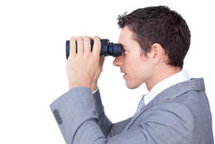 Visionary businessman looking through binoculars. Against a white background Royalty Free Stock Photo