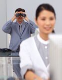 Visionary businessman using binoculars Royalty Free Stock Photos