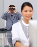 Visionary businessman using binoculars Royalty Free Stock Photos