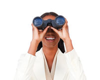 Visionary businesswoman looking through binoculars Royalty Free Stock Photos