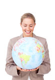 Visionary businesswoman smiling at a globe Royalty Free Stock Photography