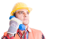 Visionary and confident builder using phone Stock Photos