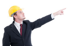 Visionary contractor or architect looking and poiting finger up Stock Photo