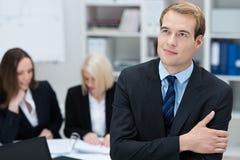 Visionary employee thinking of development Stock Photo