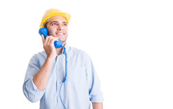 Visionary engineer talking on the phone. And looking up Stock Photo