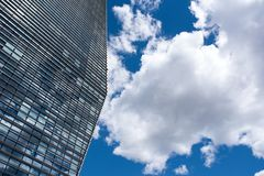 Modern skyscraper with reflections of clouds on windows royalty free stock photos