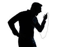 Visiophone de téléphone de verticale d'homme de silhouette Photos libres de droits