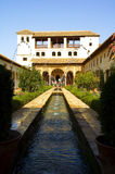 Visit Alhambra. Group of tourists visiting the Alhambra in Granada Stock Image