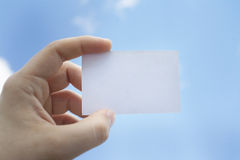 Visit card in the left hand Royalty Free Stock Images