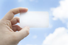Man hold a visit card in left hand Stock Images