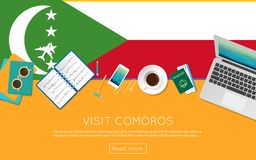 Visit Comoros concept for your web banner or. Visit Comoros concept for your web banner or print materials. Top view of a laptop, sunglasses and coffee cup on Royalty Free Stock Image