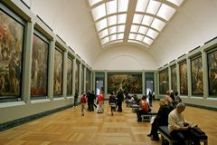 Visit day. Paintings room at Louvre Museum Stock Images