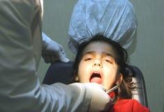 Visit at the dentist. Young girl visit at the dentist Royalty Free Stock Photos