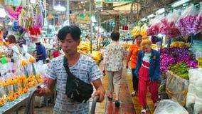 Visit Flower Market, Bangkok, Thailand. BANGKOK, THAILAND - APRIL 23, 2019: Interior of Pak Khlong Talat flower market with narrow alleyway, surrounded by stock video footage