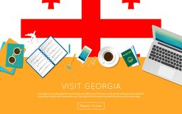 Visit Georgia concept for your web banner or. Visit Georgia concept for your web banner or print materials. Top view of a laptop, sunglasses and coffee cup on Stock Photos