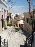 Visit Greece 5. A view of a small street in Athens center with the city panorama on the background Stock Image