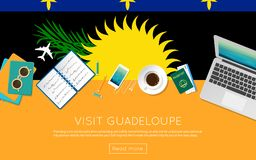 Visit Guadeloupe concept for your web banner or. Visit Guadeloupe concept for your web banner or print materials. Top view of a laptop, sunglasses and coffee Royalty Free Stock Photo