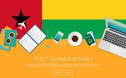 Visit Guinea-Bissau concept for your web banner. Visit Guinea-Bissau concept for your web banner or print materials. Top view of a laptop, sunglasses and coffee Royalty Free Stock Photography