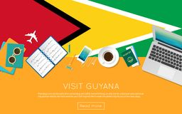 Visit Guyana concept for your web banner or print. Visit Guyana concept for your web banner or print materials. Top view of a laptop, sunglasses and coffee cup Royalty Free Stock Photos