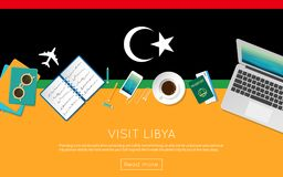 Visit Libya concept for your web banner or print. Visit Libya concept for your web banner or print materials. Top view of a laptop, sunglasses and coffee cup on Royalty Free Stock Photo