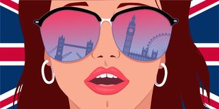 Visit London, learn English. Portrait of a young woman in big sunglasses with the reflection of London landmarks in it Royalty Free Stock Photography