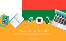 Visit Madagascar concept for your web banner or. Visit Madagascar concept for your web banner or print materials. Top view of a laptop, sunglasses and coffee Royalty Free Stock Image