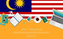 Visit Malaysia concept for your web banner or. Visit Malaysia concept for your web banner or print materials. Top view of a laptop, sunglasses and coffee cup on Royalty Free Stock Images