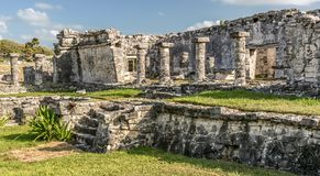 A visit in Maya civilization at Tulum. At Tulum in Yucatan, Mexico, you can combine visit to Maya ruins and sand beach pleasure stock photo