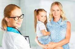 Visit mother and child to doctor pediatrician Stock Images